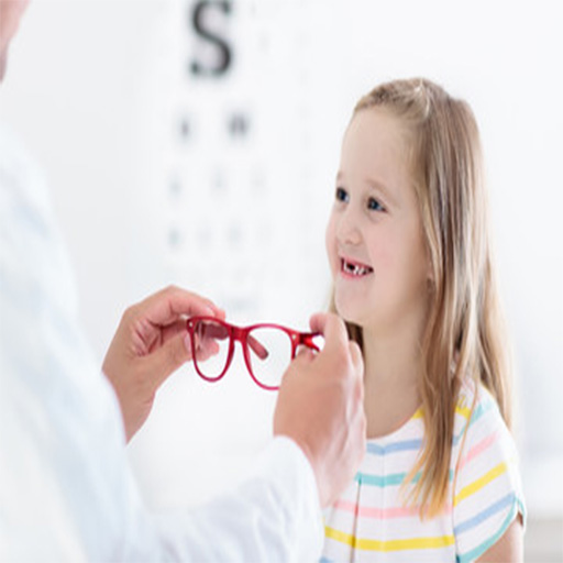 A young blond girl smiling at her optometrist while he is giving her red eyeglasses to try